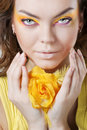 Beautiful woman with yellow rose Stock Images