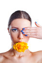 Beautiful woman with yellow rose flower in her mouth Stock Photos
