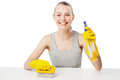 Beautiful woman in yellow rubber gloves over white attractive young sits at table holding brush and spray Royalty Free Stock Photography