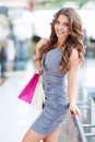 Beautiful woman young girl with bags in a store Stock Image