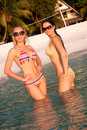 Beautiful women in bikini standing in water Royalty Free Stock Images