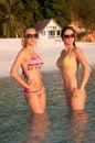 Beautiful women in bikini standing in water Stock Photography