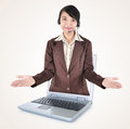 Beautiful women entrepreneurs out of a laptop with open arms woman isolated on brown background Stock Photos