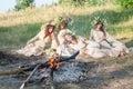 Beautiful women with flower wreath near bonfire Royalty Free Stock Photo