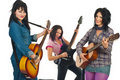 Beautiful women with guitars in concert Stock Photography