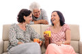 Beautiful women having fun at home senior lady listening Royalty Free Stock Photo