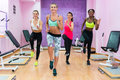 Beautiful women running on the spot during HIIT workout class in Royalty Free Stock Photo