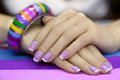 Beautiful women s manicure with purple polish on the nails Stock Photos