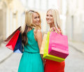 Beautiful women with shopping bags in the ctiy sale and tourism happy people concept Stock Photos