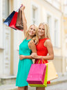 Beautiful women with shopping bags in the ctiy sale and tourism happy people concept Royalty Free Stock Images