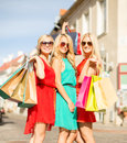 Beautiful women with shopping bags in the ctiy sale and tourism happy people concept blonde Royalty Free Stock Images