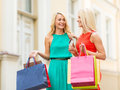 Beautiful women with shopping bags in the ctiy sale and tourism happy people concept and credit card Stock Photos