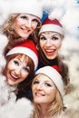 Beautiful women wearing a santa hat Stock Photos