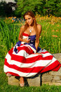 Beautiful women wrapped in the American Flag Royalty Free Stock Photo