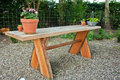 Beautiful wooden garden table hand made craft rustic with flowers Royalty Free Stock Images