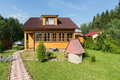 Beautiful wooden house in the countryside in summer Royalty Free Stock Photo