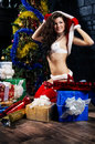 Beautiful xmass brunette as snow maiden near the new year tree a wearing sexy posing over christmas background Royalty Free Stock Photos