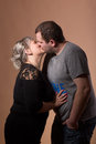 Beautiful xxl woman kissing her husband studio shoot of fashion women happy couple love concept Stock Images