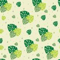 stock image of  Beautiful yellow seamless pattern of green palm leaves repeating elements.