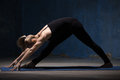 Beautiful Yoga Woman Doing Intense Side Stretch Pose