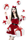 Beautiful youn brunette woman christmas portrait with many gifts Royalty Free Stock Image