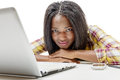 Beautiful young African American teenage girl with laptop Royalty Free Stock Photo