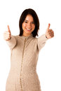 Beautiful young asian caucasian woman in sweater showing thumb up isolated over white background Royalty Free Stock Image