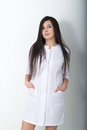 Beautiful young asian female doctor in medical gown holding a phonendoscope Royalty Free Stock Photo