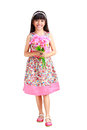 Beautiful young asian girl in a dress with a flower in her hand isolated over white clipping path Stock Photos