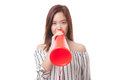 Beautiful young Asian woman announce with megaphone. Royalty Free Stock Photo