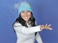 Beautiful young Asian woman blowing snow - winter Royalty Free Stock Images