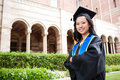 Beautiful young asian woman in graduation gown Royalty Free Stock Photo