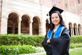 Beautiful young asian woman in graduation gown Royalty Free Stock Image