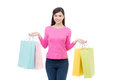 Beautiful young asian woman holding colored shopping bags Royalty Free Stock Photo