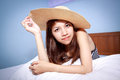 Beautiful young Asian woman relaxing on the bed Royalty Free Stock Images