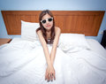 Beautiful young Asian woman relaxing on the bed Royalty Free Stock Photography