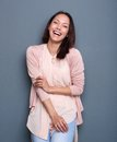 Beautiful young asian woman smiling portrait of a mixed race on fray background Stock Photo