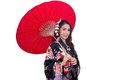 Beautiful young asian woman wearing traditional japanese kimono with red umbrella isolated on white background Royalty Free Stock Photo