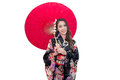 Beautiful young asian woman wearing traditional japanese kimono with red umbrella isolated on white background Stock Photography