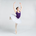 Beautiful young ballet dancer on a gray background Stock Image