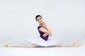 Beautiful young ballet dancer on a gray background Stock Images