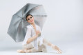 Beautiful young ballet dancer on a gray background Royalty Free Stock Image