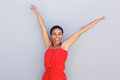 Beautiful young black woman smiling with arms raised Royalty Free Stock Photo