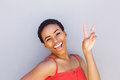 Beautiful young black woman smiling with peace hand sign Royalty Free Stock Photo