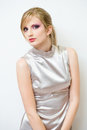 Beautiful young  blond in retro style silver dress Stock Photography