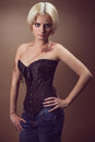 Beautiful young blond woman in a corset Stock Photography