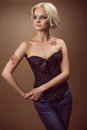 Beautiful young blond woman in a corset Stock Photo