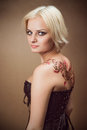 Beautiful young blond woman in a corset Royalty Free Stock Image