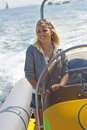Beautiful Young Blond Woman Driving A Speedboat Royalty Free Stock Images