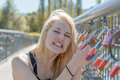 Beautiful young blond woman holding padlocks Royalty Free Stock Photo